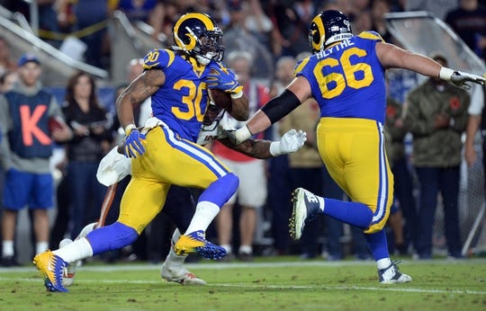 November 17, 2019; Los Angeles, CA, USA; Los Angeles Rams running back Todd Gurley (30) runs the ball as offensive guard Austin Blythe (66) provides coverage against the Chicago Bears during the first half at the Los Angeles Memorial Coliseum. Mandatory Credit: Gary A. Vasquez-USA TODAY Sports
