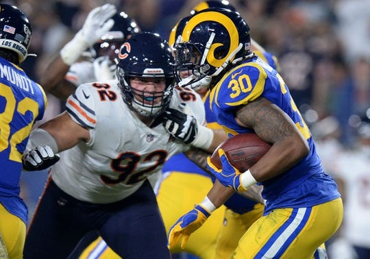 November 17, 2019; Los Angeles, CA, USA; Los Angeles Rams running back Todd Gurley (30) runs the ball as Chicago Bears defensive end Brent Urban (92) moves in during the first half at the Los Angeles Memorial Coliseum. Mandatory Credit: Gary A. Vasquez-USA TODAY Sports