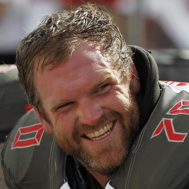 Sep 7, 2014; Tampa, FL, USA; Tampa Bay Buccaneers guard Logan Mankins (70) smiles on the bench during the first half against the Carolina Panthers at Raymond James Stadium. Mandatory Credit: Kim Klement-USA TODAY Sports