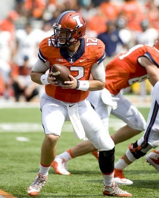 Sep 5, 2015; Champaign, IL, USA; Illinois Fighting Illini quarterback Wes Lunt (12) hands the ball off against the Kent State Golden Flashes at Memorial Stadium. Mandatory Credit: Mike Granse-USA TODAY Sports