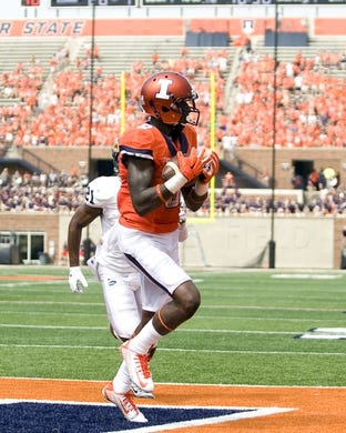 Sep 5, 2015; Champaign, IL, USA; Illinois Fighting Illini wide receiver Geronimo Allison (8) scores a touchdown against the Kent State Golden Flashes at Memorial Stadium. Mandatory Credit: Mike Granse-USA TODAY Sports