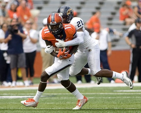 Sep 5, 2015; Champaign, IL, USA; Illinois Fighting Illini wide receiver Malik Turner (11) is tackled by Kent State Golden Flashes cornerback Demetrius Monday (21 ) at Memorial Stadium. Illinois beat Kent State 52-3.  Mandatory Credit: Mike Granse-USA TODAY Sports