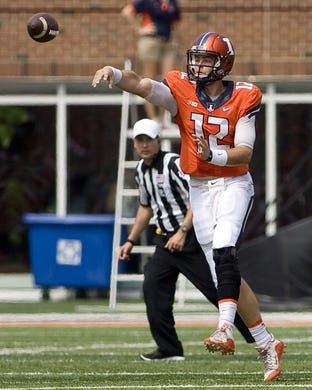 Sep 5, 2015; Champaign, IL, USA; Illinois Fighting Illini quarterback Wes Lunt (12) throws a pass at Memorial Stadium. Illinois beat Kent State 52-3.  Mandatory Credit: Mike Granse-USA TODAY Sports