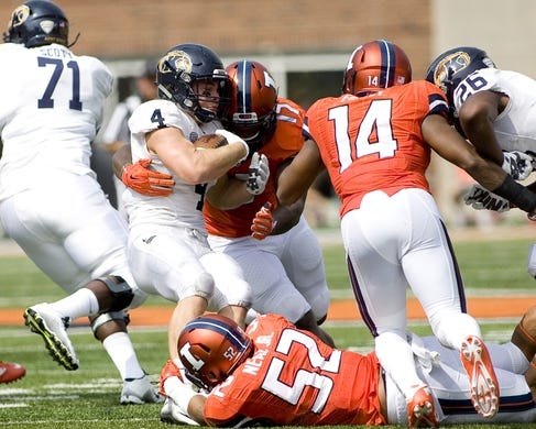 Sep 5, 2015; Champaign, IL, USA; Kent State Golden Flashes quarterback Colin Reardon (10) is sacked by Illinois Fighting Illini defensive lineman Jihad Ward (17) and linebacker T.J. Neal (52) at Memorial Stadium. Illinois beat Kent State 52-3.  Mandatory Credit: Mike Granse-USA TODAY Sports