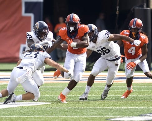 Sep 5, 2015; Champaign, IL, USA; Illinois Fighting Illini running back Ke'Shawn Vaughn (5) carries the ball at Memorial Stadium. Illinois beat Kent State 52-3.  Mandatory Credit: Mike Granse-USA TODAY Sports