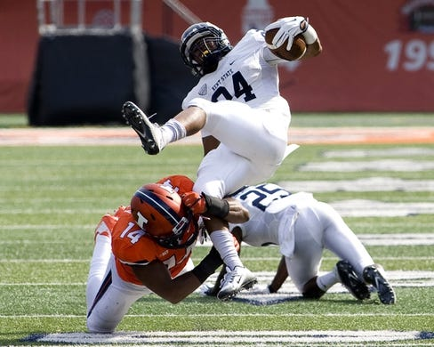 Sep 5, 2015; Champaign, IL, USA; Illinois Fighting Illini safety Eric Finney (14) tackles Kent State Golden Flashes running back Raekwon James (24) at Memorial Stadium. Illinois beat Kent State 52-3.  Mandatory Credit: Mike Granse-USA TODAY Sports