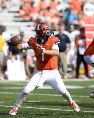 Sep 5, 2015; Champaign, IL, USA; Illinois Fighting Illini quarterback Chayce Crouch (7) throws a pass at Memorial Stadium. Illinois beat Kent State 52-3.  Mandatory Credit: Mike Granse-USA TODAY Sports
