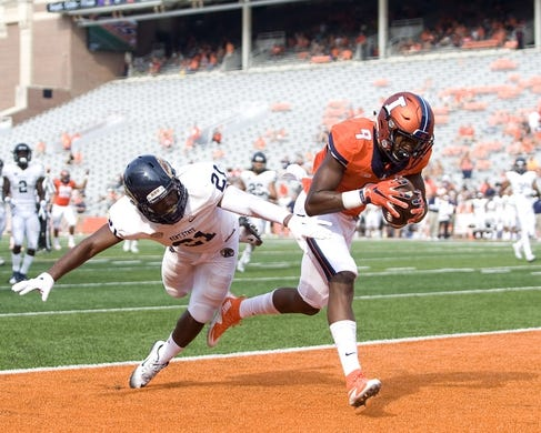 Sep 5, 2015; Champaign, IL, USA; Illinois Fighting Illini wide receiver Sam Mays (9) catches a touchdown pass over Kent State Golden Flashes cornerback Demetrius Monday (21) at Memorial Stadium. Illinois beat Kent State 52-3.  Mandatory Credit: Mike Granse-USA TODAY Sports