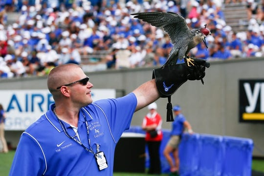 Sep 5, 2015; Colorado Springs, CO, USA; Air Force Technical Sergeant Vernon Thompson displays a peregrine falcon in the third quarter of the game against the Morgan State Bears at Falcon Stadium. The Falcons defeated the Bears 63-7. Mandatory Credit: Isaiah J. Downing-USA TODAY Sports