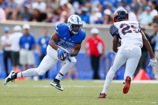 Sep 5, 2015; Colorado Springs, CO, USA; Air Force Falcons wide receiver Tyler Williams (12) runs the ball against Morgan State Bears defensive back Darius Johnson (25) in the third quarter at Falcon Stadium. The Falcons defeated the Bears 63-7. Mandatory Credit: Isaiah J. Downing-USA TODAY Sports