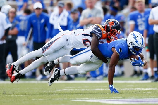 Sep 5, 2015; Colorado Springs, CO, USA; Morgan State Bears defensive back Darius Johnson (25) tackles Air Force Falcons wide receiver Tyler Williams (12) in the third quarter at Falcon Stadium. The Falcons defeated the Bears 63-7. Mandatory Credit: Isaiah J. Downing-USA TODAY Sports