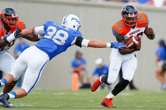 Sep 5, 2015; Colorado Springs, CO, USA; Morgan State Bears quarterback Moses Skillon (12) dodges the tackle of Air Force Falcons defensive tackle Kellen Cleveland (38) in the third quarter at Falcon Stadium. The Falcons defeated the Bears 63-7. Mandatory Credit: Isaiah J. Downing-USA TODAY Sports