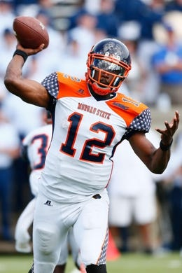 Sep 5, 2015; Colorado Springs, CO, USA; Morgan State Bears quarterback Moses Skillon (12) passes in the third quarter against the Air Force Falcons at Falcon Stadium. The Falcons defeated the Bears 63-7. Mandatory Credit: Isaiah J. Downing-USA TODAY Sports