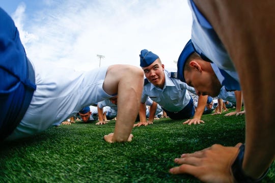 Sep 5, 2015; Colorado Springs, CO, USA; Private fourth class Michael Plaza does pushups with other freshman following an Air Force Falcons touchdown in the third quarter against the Morgan State Bears at Falcon Stadium. The Falcons defeated the Bears 63-7. Mandatory Credit: Isaiah J. Downing-USA TODAY Sports