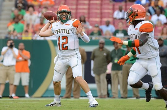 Sep 5, 2015; Tampa, FL, USA; Florida A & M Rattlers  quarterback Carson Royal (12) throws the ball in the first half against the South Florida Bulls at Raymond James Stadium. Mandatory Credit: Jonathan Dyer-USA TODAY Sports
