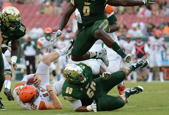 Sep 5, 2015; Tampa, FL, USA; Florida A & M Rattlers  quarterback Carson Royal (12)  gets sacked by South Florida Bulls defensive tackle Bruce Hector (60) in the first half at Raymond James Stadium. Mandatory Credit: Jonathan Dyer-USA TODAY Sports