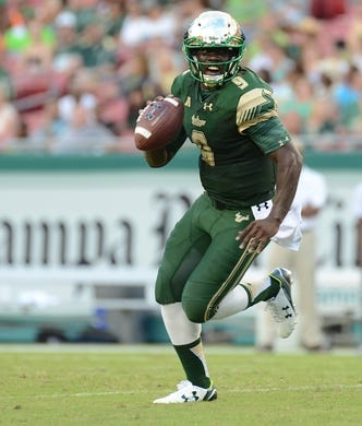 Sep 5, 2015; Tampa, FL, USA; South Florida Bulls quarterback Quentin Flowers (9) runs the ball during the  half against the Florida A & M Rattlers at Raymond James Stadium. Mandatory Credit: Jonathan Dyer-USA TODAY Sports