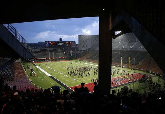 Sep 5, 2015; Cincinnati, OH, USA; The student section rushes the field during a rain delay prior to the game of the Cincinnati Bearcats against the Alabama A&M Bulldogs at Nippert Stadium. Mandatory Credit: Aaron Doster-USA TODAY Sports