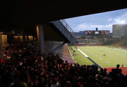 Sep 5, 2015; Cincinnati, OH, USA; Fans stand in the concourse to avoid the rain during a rain delay prior to the game of the Cincinnati Bearcats against the Alabama A&M Bulldogs at Nippert Stadium. Mandatory Credit: Aaron Doster-USA TODAY Sports