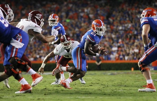 Sep 5, 2015; Gainesville, FL, USA; Florida Gators running back Kelvin Taylor (21) runs the ball in for a touchdown against the New Mexico State Aggies during the first half at Ben Hill Griffin Stadium. Mandatory Credit: Kim Klement-USA TODAY Sports