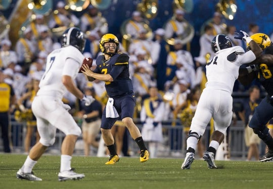 Sep 5, 2015; Morgantown, WV, USA; West Virginia Mountaineers quarterback Skyler Howard looks to pass during the first half against the Georgia Southern Eagles at Milan Puskar Stadium. Mandatory Credit: Ben Queen-USA TODAY Sports