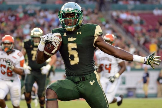 Sep 5, 2015; Tampa, FL, USA; South Florida Bulls running back Marlon Mack (5) celebrates as he heads for the end zone during the  half against the Florida A & M Rattlers at Raymond James Stadium. The touchdown was called back for taunting . Mandatory Credit: Jonathan Dyer-USA TODAY Sports