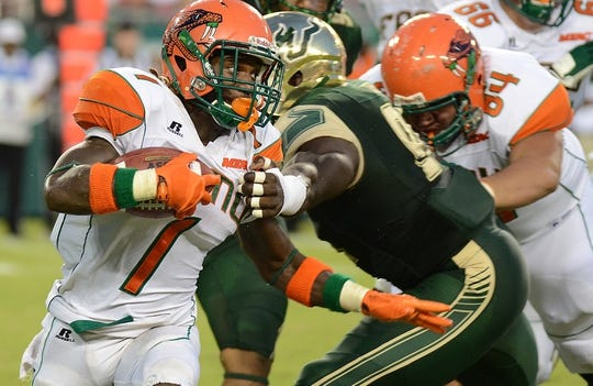 Sep 5, 2015; Tampa, FL, USA; Florida A & M Rattlers  running back Devondrick Nealy (1) runs the ball in the first half against the South Florida Bulls at Raymond James Stadium. Mandatory Credit: Jonathan Dyer-USA TODAY Sports