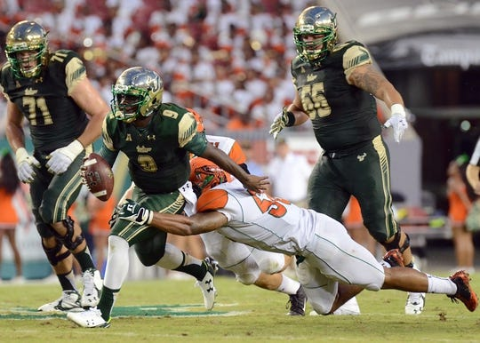 Sep 5, 2015; Tampa, FL, USA; South Florida Bulls quarterback Quentin Flowers (9)runs  the the ball during the  half against the Florida A & M Rattlers at Raymond James Stadium. Mandatory Credit: Jonathan Dyer-USA TODAY Sports