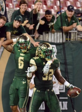 Sep 5, 2015; Tampa, FL, USA; South Florida Bulls D'Ernest Johnson (32) and A.J. Degree (6) celebrate after a touchdown during the  half against the Florida A & M Rattlers at Raymond James Stadium. Mandatory Credit: Jonathan Dyer-USA TODAY Sports