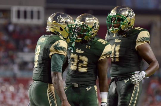 Sep 5, 2015; Tampa, FL, USA; South Florida Bulls D'Ernest Johnson (32) celebrates after scoring a touchdown during the  half against the Florida A & M Rattlers at Raymond James Stadium. Mandatory Credit: Jonathan Dyer-USA TODAY Sports