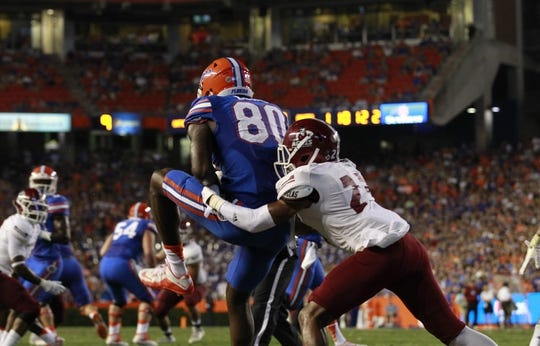 Sep 5, 2015; Gainesville, FL, USA; Florida Gators tight end C'yontai Lewis (80) scores a touchdown against the New Mexico State Aggies during the second quarter at Ben Hill Griffin Stadium. Mandatory Credit: Kim Klement-USA TODAY Sports