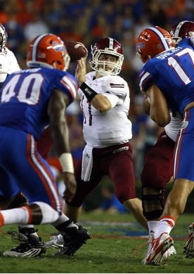 Sep 5, 2015; Gainesville, FL, USA; New Mexico State Aggies quarterback Tyler Rogers (17) throws the ball during the second quarter against the Florida Gators at Ben Hill Griffin Stadium. Mandatory Credit: Kim Klement-USA TODAY Sports