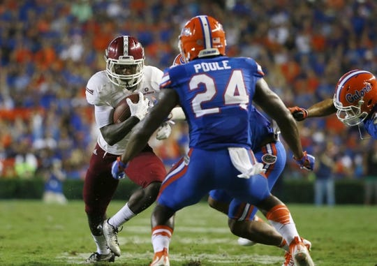 Sep 5, 2015; Gainesville, FL, USA; New Mexico State Aggies wide receiver Teldrick Morgan (1) runs with the ball as Florida Gators defensive back Brian Poole (24) defends during the second quarter at Ben Hill Griffin Stadium. Mandatory Credit: Kim Klement-USA TODAY Sports