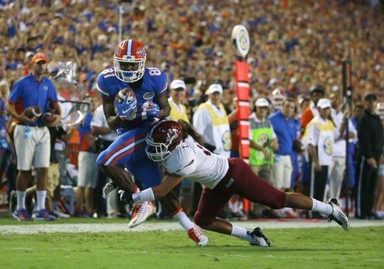 Sep 5, 2015; Gainesville, FL, USA; Florida Gators wide receiver Antonio Callaway (81) catches the ball as New Mexico State Aggies defensive back Kawe Johnson (16) attempted to defend during the second quarter at Ben Hill Griffin Stadium. Mandatory Credit: Kim Klement-USA TODAY Sports