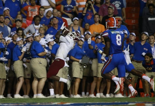 Sep 5, 2015; Gainesville, FL, USA; New Mexico State Aggies wide receiver Teldrick Morgan (1) catches the ball for a touchdown against the Florida Gators during the second quarter at Ben Hill Griffin Stadium. Mandatory Credit: Kim Klement-USA TODAY Sports