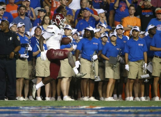 Sep 5, 2015; Gainesville, FL, USA; New Mexico State Aggies wide receiver Teldrick Morgan (1) reacts after he catches the ball for a touchdown against the Florida Gators during the second quarter at Ben Hill Griffin Stadium. Mandatory Credit: Kim Klement-USA TODAY Sports