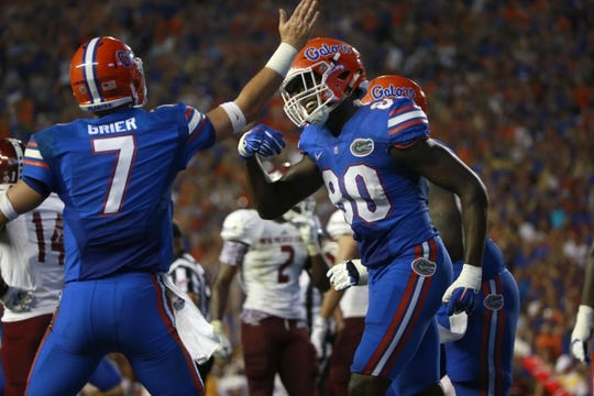 Sep 5, 2015; Gainesville, FL, USA; Florida Gators tight end C'yontai Lewis (80) is congratulated by quarterback Will Grier (7) as he  ran the ball in for a touchdown against the New Mexico State Aggies during the second quarter at Ben Hill Griffin Stadium. Mandatory Credit: Kim Klement-USA TODAY Sports