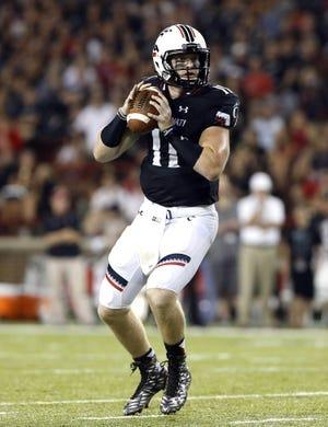 Sep 5, 2015; Cincinnati, OH, USA; Cincinnati Bearcats quarterback Gunner Kiel (11) looks to pass in the first half against the Alabama A&M Bulldogs at Nippert Stadium. Mandatory Credit: Aaron Doster-USA TODAY Sports