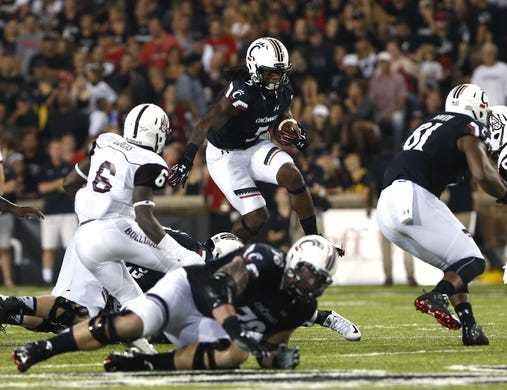 Sep 5, 2015; Cincinnati, OH, USA; Cincinnati Bearcats running back Mike Boone (5) carries the ball in the first half against the Alabama A&M Bulldogs at Nippert Stadium. Mandatory Credit: Aaron Doster-USA TODAY Sports