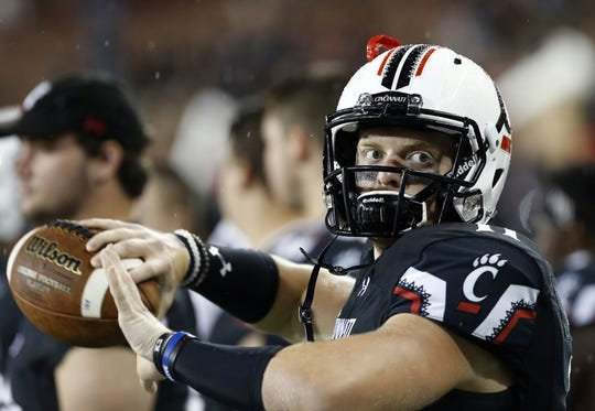 Sep 5, 2015; Cincinnati, OH, USA; Cincinnati Bearcats quarterback Gunner Kiel (11) throws a pass while on the sidelines in the first half against the Alabama A&M Bulldogs at Nippert Stadium. Mandatory Credit: Aaron Doster-USA TODAY Sports