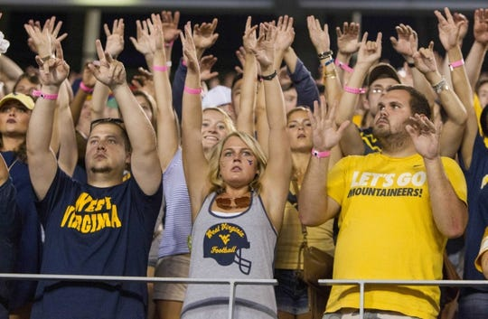 Sep 5, 2015; Morgantown, WV, USA; West Virginia Mountaineers fans cheer during the third quarter against the Georgia Southern Eagles at Milan Puskar Stadium. Mandatory Credit: Ben Queen-USA TODAY Sports