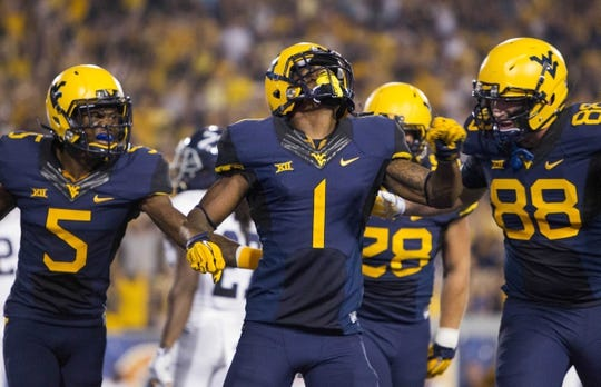 Sep 5, 2015; Morgantown, WV, USA; West Virginia Mountaineers wide receiver Shelton Gibson celebrates with teammates after scoring in the second half against the Georgia Southern Eagles at Milan Puskar Stadium.  Mandatory Credit: Ben Queen-USA TODAY Sports