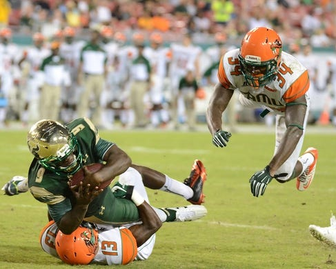 Sep 5, 2015; Tampa, FL, USA; South Florida Bulls quarterback Quentin Flowers (9) runs the ball during the second half against the Florida A & M Rattlers at Raymond James Stadium. Mandatory Credit: Jonathan Dyer-USA TODAY Sports
