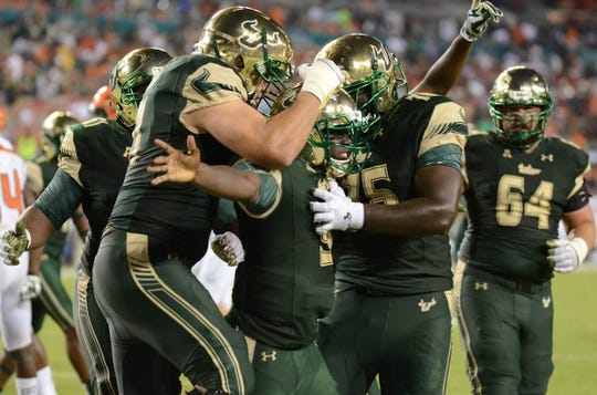 Sep 5, 2015; Tampa, FL, USA; South Florida Bulls quarterback Quentin Flowers (9) celebrates after scoring a touchdown during the second half against the Florida A & M Rattlers at Raymond James Stadium. Mandatory Credit: Jonathan Dyer-USA TODAY Sports