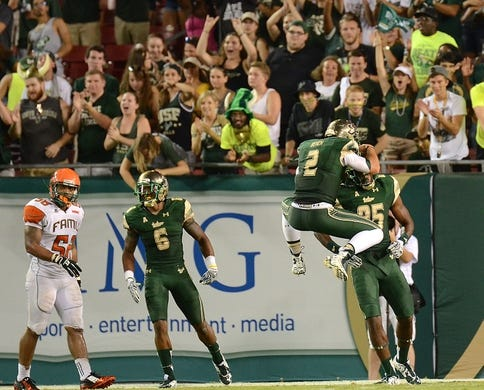 Sep 5, 2015; Tampa, FL, USA; South Florida Bulls quarterback Steven Bench (2) celebrates with wide receiver Elkanah Dillon (85) after a touchdown in the second half  at Raymond James Stadium. Mandatory Credit: Jonathan Dyer-USA TODAY Sports