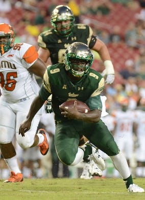 Sep 5, 2015; Tampa, FL, USA; South Florida Bulls quarterback Quentin Flowers (9) runs the ball in the second half against the Florida A & M Rattlers at Raymond James Stadium. Mandatory Credit: Jonathan Dyer-USA TODAY Sports