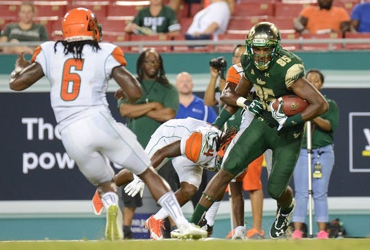 Sep 5, 2015; Tampa, FL, USA; South Florida Bulls wide receiver Elkanah Dillon (85) runs with the ball in the second half against the Florida A & M Rattlers at Raymond James Stadium. The South Florida Bulls defeated the Florida A & M Rattlers 51-3. Mandatory Credit: Jonathan Dyer-USA TODAY Sports