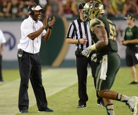 Sep 5, 2015; Tampa, FL, USA; South Florida Bulls head coach Willie Taggart reacts after his team scores a touchdown in the second half  against the Florida A & M Rattlers at Raymond James Stadium. The South Florida Bulls defeated the Florida A & M Rattlers 51-3. Mandatory Credit: Jonathan Dyer-USA TODAY Sports