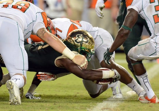 Sep 5, 2015; Tampa, FL, USA; South Florida Bulls running back Marlon Mack (5) reaches for the goal line in the second half against the Florida A & M Rattlers at Raymond James Stadium. The South Florida Bulls defeated the Florida A & M Rattlers 51-3. Mandatory Credit: Jonathan Dyer-USA TODAY Sports