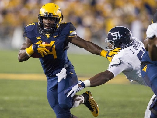 Sep 5, 2015; Morgantown, WV, USA; West Virginia Mountaineers running back Wendell Smallwood runs for a touchdown during the fourth quarter against the Georgia Southern Eagles at Milan Puskar Stadium.  Mandatory Credit: Ben Queen-USA TODAY Sports